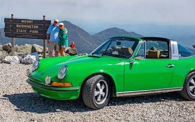 Alan Klein and wife Jodi Cohen Klein pose beside their 1973 viper green Porsche 911 Targa. The photo was taken before the Kleins realized that their car needed to be push started down Mount Washington in New Hampshire.   Photo courtesy of Alan H. Klein