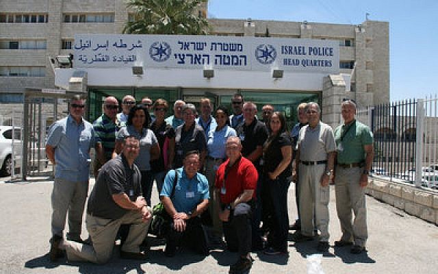 Georgia police officers taking part in the GILEE program pose in front of Israeli Police headquarters.  Photo courtesy of Georgia State University