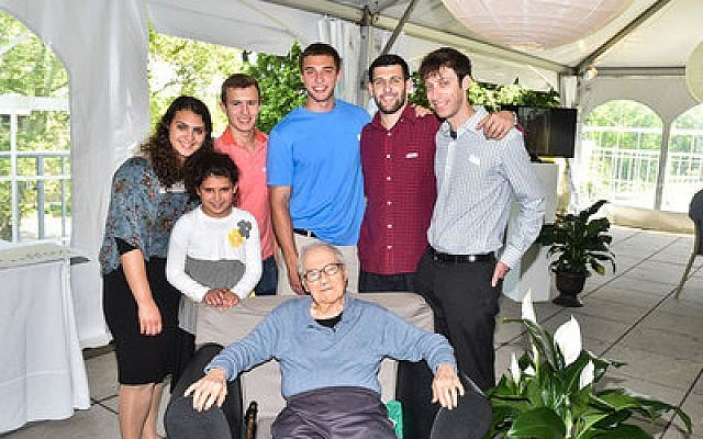 Arthur Plotkin poses for a photo with his grandchildren (from left) Rivka, Miriam, Yehuda, Jesse, Andrew and David. Photo courtesy of Maxine Plotkin
