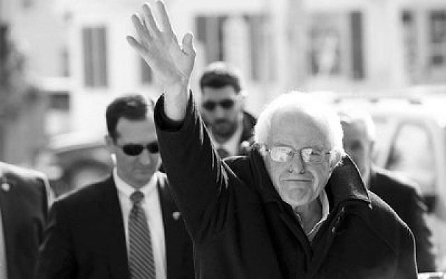 Bernie Sanders waves to his supporters during the New Hampshire primary last February. Photo by Spencer Platt/Getty Images