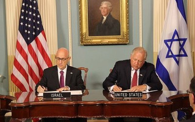 Jacob Nagel, Israel's acting national security adviser, signs a Memorandum of Understanding for $38 billion of U.S. defense assistance over 10 years with Undersecretary of State Tom Shannon. Photo courtesy of the Embassy of Israel