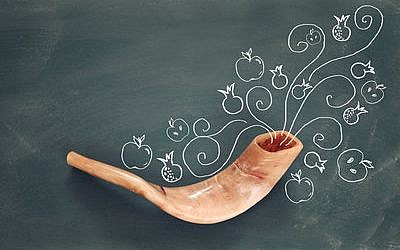 Rosh hashanah (Jewish New Year holiday) concept over blackboard with hand made illustrations. (File photo)