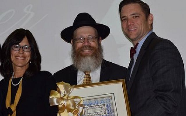 Sean McGreevey poses with Sara and Shmuel Weinstein of Chabad House on Campus. McGreevey, former assistant dean at Chatham University, said that Chabad on Campus is successful because of its student engagement.  Photo courtesy of Adam Richman