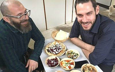 Jalil Dabit (left) and Arab Christian from Ramallah, and Oz Ben David, who grew up Jewish in Beersheba, opened the restaurant together.Photo by Toby Axelrod