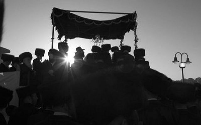 Chasidic Jewish men celebrate a wedding in Israel, where marriage and divorce is legally under the authority of the Orthodox Chief Rabbinate.	Photo by Yaakov Lederman/Flash9