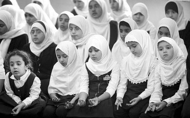 Students at a Muslim elementary school in Morton Grove, Ill., pray in the school gymnasium. Photo by Scott Olson/Getty Images