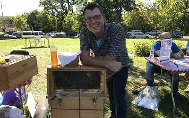 Steve Kroser is a local apiarist whose interest is in helping bees more than producing commercial honey.  Photo by Jim Busis