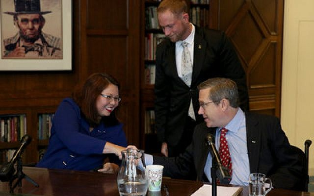 Tammy Duckworth and Sen. Mark Kirk shake hands after their debate at the Chicago Tribune in October.  Photo by Nancy Stone/Chicago Tribune/TNS via Getty Images