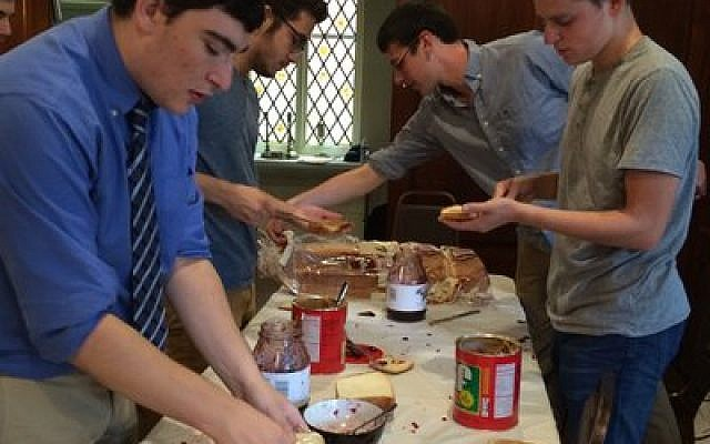 University of Pittsburgh students slather on the peanut butter and jelly.  Photo by Toby Tabachnick