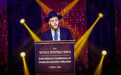 Rabbi Mendel Alperowitz addresses attendees of the International Conference of Chabad-Lubavitch Emissaries last week. 	Photo by Eliyahu Parypa/Chabad.org