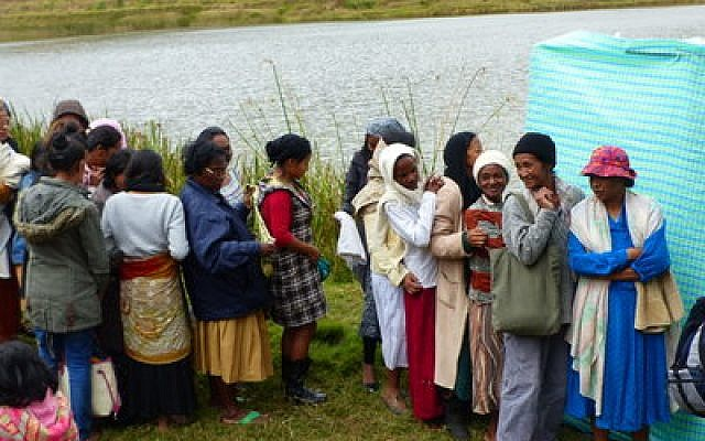 Malagasy women prepare to immerse in a river before converting to Judaism, near Antananarivo.	Photo by Deborah Josefson