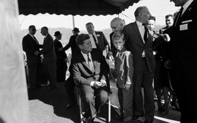 President John F. Kennedy meets with a young boy during a congressional campaign rally at the municipal parking lot at City Hall in McKeesport in 1962.  Photo by Cecil Stoughton/White House Photographs. John F. Kennedy Presidential Library and Museum, Boston