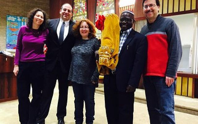 Rabbis Amy and Alex Greenbaum (left), Francine Rosenthal, Rabbi Gershom Sizomu and President Cliff Spungen are all smiles for the Global Day of Jewish Learning after Beth El Congregation of the South Hills donated a Torah for use in Uganda. Photo courtesy of Steve Hecht of Beth El Congregation of the South Hills