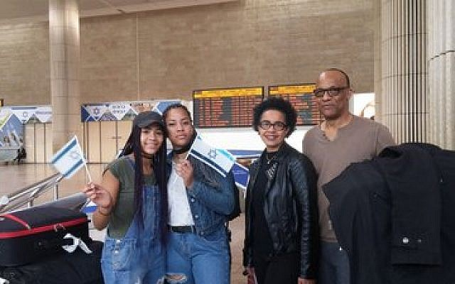 George and Amy Camara and two of their four children arrive in Israel.   Photo courtesy of the International Fellowship of Christians and Jews