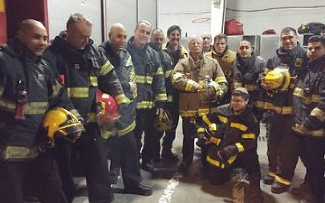 American and Israeli firefighters get together for a photograph after returning from a call in Jerusalem last week. 	Photo courtesy of Emergency Volunteers Project