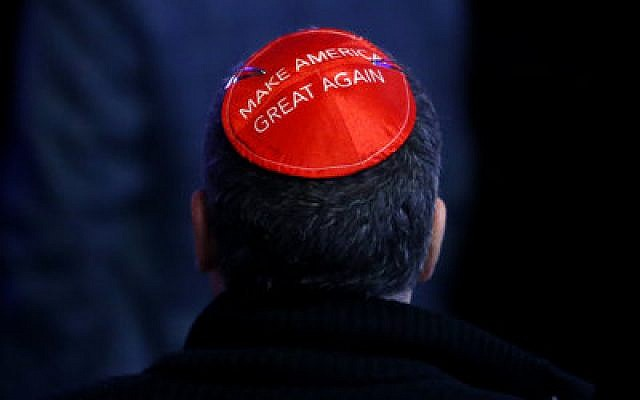 A man wears his support for Donald Trump on his kippah at Trump's election night event in New York City.   Photo by Jessica Rinaldi/The Boston Globe via Getty Images