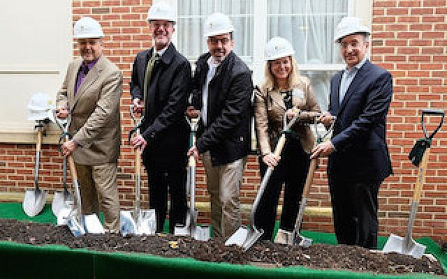 The JAA board of directors and Dr. John Zeisel ceremonially break ground on the new memory care building.	  Photo by Sandy Riemer