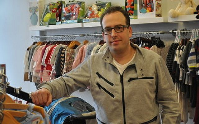 Paul Kenney owns Kidz & Company, a children's clothing store on Forbes Avenue.  Photo by Adam Reinherz
