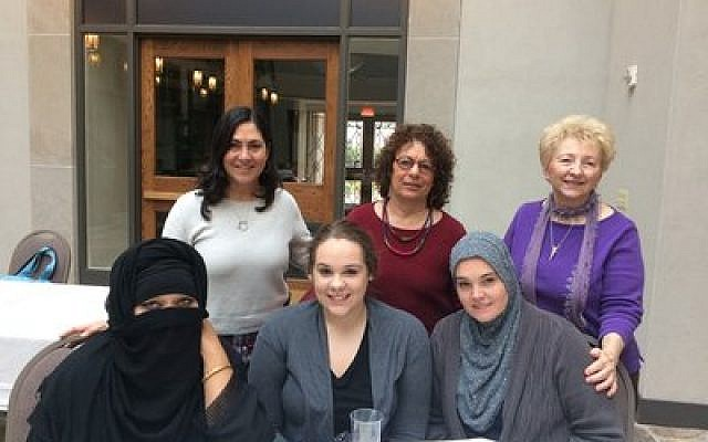 Julie Newman (back row, left) and Malke Frank (back row, center) join with women from the Islamic Center of Pittsburgh and others to share stories and forge connections.	Photo by Toby Tabachnick