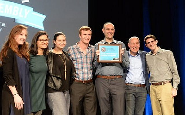 Members of Pittsburgh's Hillel Jewish University Center proudly show off their award. From left: Elina Lipov, Robyn Markowitz Lawler, Julia Katz, Matthew Callman, Dan Marcus, Eric D. Fingerhut and Alex Zissman.							Photo by Geoffrey Melada/Hillel International