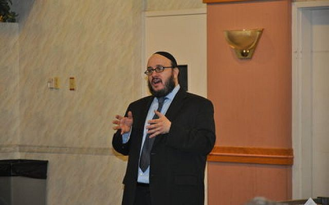 Rabbi Daniel Yolkut addresses the significance of the date of the 10th of Tevet. Photo by Adam Reinherz