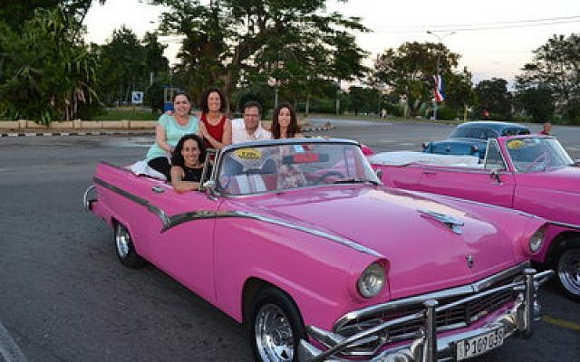 Travelers with Amazing Journeys in Cuba are out for a night of sightseeing.  Photo provided by Amazing Journeys