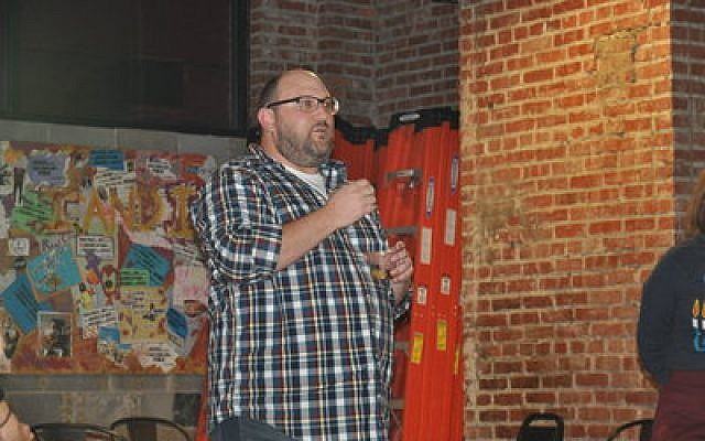 Zack Block addresses attendees at Repair the World's Chanukah party.	Photo by Adam Reinherz