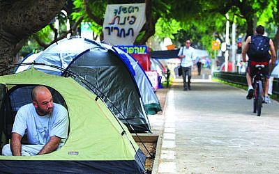 Tel Aviv residents protest the high cost of living in 2011. Photo by Liron Almog/Flash90