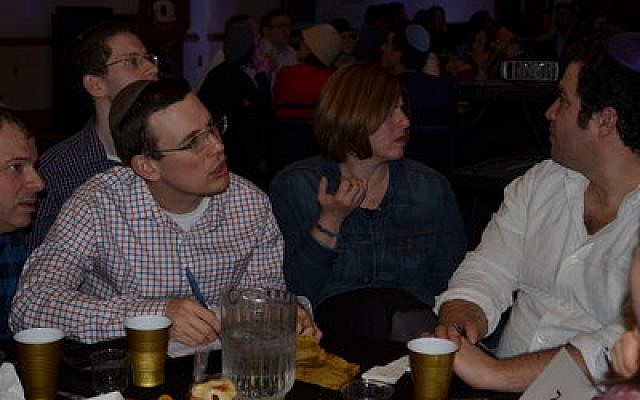 The trivia contest was as much about camaraderie as competition. Photo by Adam Reinherz