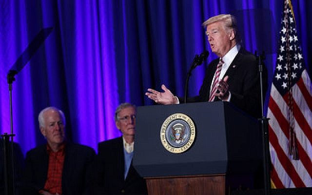 President Donald Trump addresses the audience at a January luncheon at the Congress of Tomorrow Republican Member Retreat in Philadelphia. In the background are Senate Majority Whip John Cronyn (left) and Senate Majority Leader Mitch McConnell.  Photo by Alex Wong/Getty Images