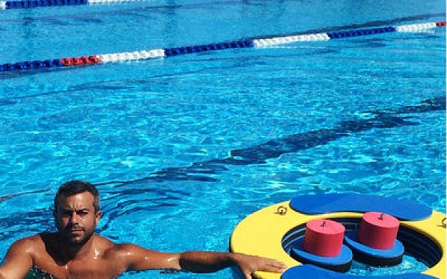 Asaf Ventura poses with his floating gym at an Israeli army rehabilitation center in Haifa. Photo courtesy of Ventura