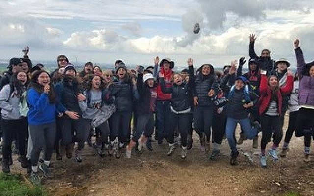 A group of high school students celebrate their time in Israel, thanks to AMHSI.	Photo courtesy of AMHSI