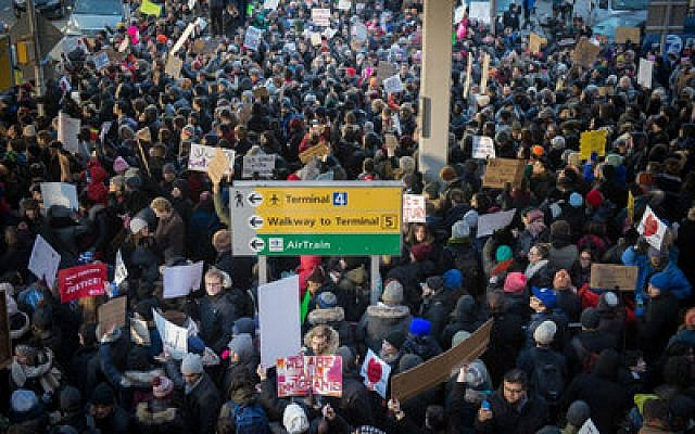 Demonstrators at John F. Kennedy Airport in New York on Saturday protest President Donald Trump's executive order banning immigrants from certain countries. 	Photo by Bryan R. Smith/AFP/Getty Images