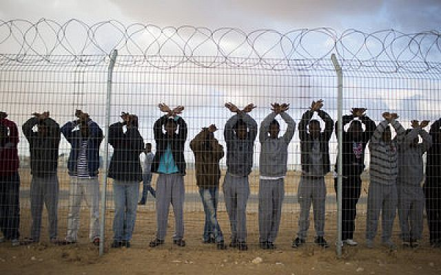 Asylum seekers protest at the Holot detention center in the southern Negev Desert of Israel.   Photo by Ilia Yefimovich/Getty Images