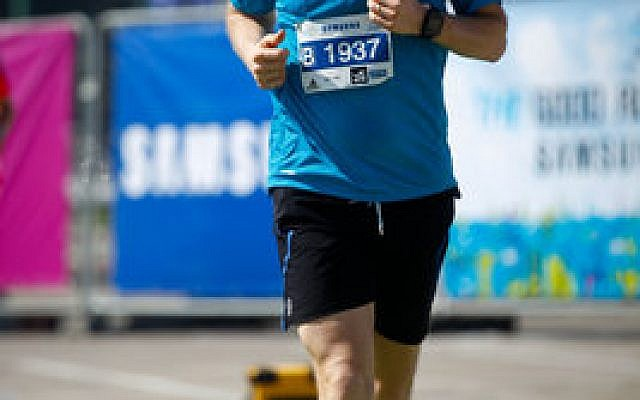 Noah Roth finishes last year's Tel Aviv Marathon.   Photo courtesy of Noah Roth