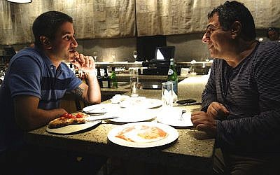 Michael Solomonov (left), star of a documentary about Israeli cuisine, is pictured with Haim Cohen, a chef, TV host, cookbook writer and restaurateur, in Tel Aviv-Jaffa.  (Florentine Films)