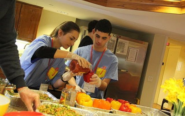 Ariana Finkelstein and Sammy Himmel make stuffed peppers for Family House (a residence for those with family members in hospitals here) as part of J-Serve 2017.	Photo courtesy of the JCC Pittsburgh
