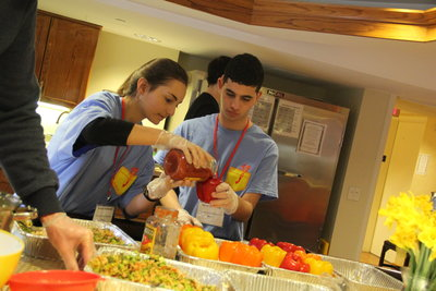 Ariana Finkelstein and Sammy Himmel make stuffed peppers for Family House (a residence for those with family members in hospitals here) as part of J-Serve 2017.Photo courtesy of the JCC Pittsburgh