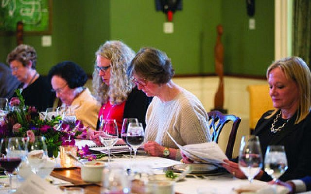 First lady Frances Wolf reads the Haggadah during the Seder.   Photos by Celia Zizzi/Flickr