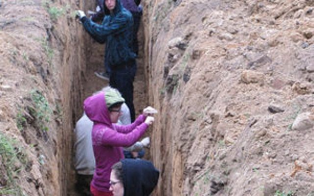 In 2012, Michael Kagan and Dror Shwartz scouted the former Novogrudok labor camp site, now an agricultural college, ultimately winning permission to bring in escapees' descendants to dig for the tunnel that their ancestors used to flee.   Photo courtesy of Michael Kagan