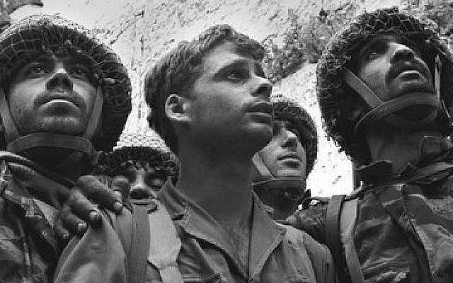 From left: Israeli paratroopers Tzion Karasenti, Yitzhak Yifat and Chaim Oshri stand at the Western Wall after Israel captured the Temple Mount in Jerusalem, June 7, 1967.  (Photo by David Rubinger)