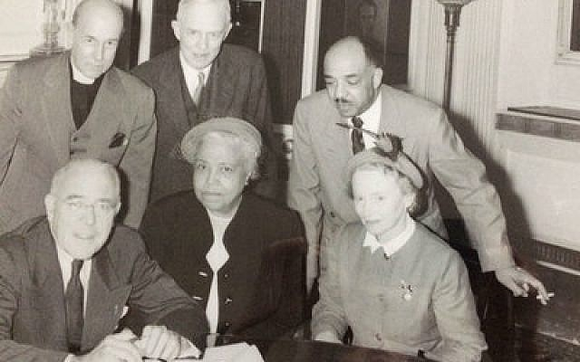 In this Teenie Harris photo, Pittsburgh Mayor David L. Lawrence (left) poses with Daisy Lampkin (center) and Florence Reizenstein at the City County Building, 1952.Carnegie Museum of Art, Teenie Harris Archive