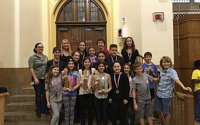 Some of the 50 area Jewish students who participated in the Odyssey of the Mind competition display their awards. (Photo courtesy of Jennifer Bails)