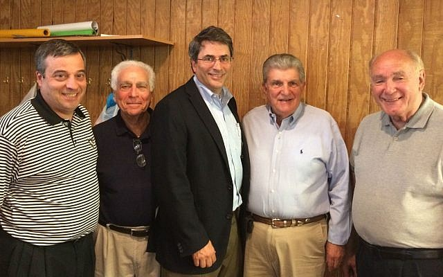 From left: Kiwanis members David Masters, Martin Grodin, David Maretsky and Robert McMurray. Dan Brandeis, director of the Jewish Community Foundation, is in the center. (Photo courtesy of David Maretsky)
