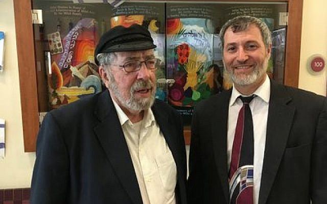 Dr. Gabriel Barkay (left), award-winning archeologist, talks with Rabbi Daniel Wasserman, of Shaare Torah Congregation. Barkay was in Pittsburgh to discuss the reunification of Jerusalem and his efforts with sifting soil from the Temple Mount.  (Photo by Danny Shaw)