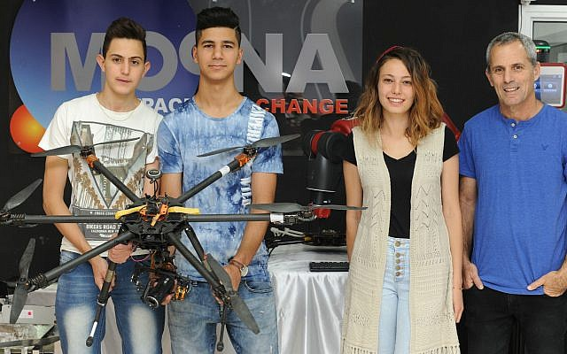 From left: Sharing first place are Ahmed Saba, 17, and Haled Abu Daud, 18, both Arab students from Majd al-Krum, who built an automatic fishing boat; second place was awarded to Rima Ali, 21, a Druze woman from Beit Jann who designed an interactive table. She is currently studying toward a bachelor's degree in law and economics at the University of Haifa; also pictured is Asaf Brimer, CEO and founder of Moona. (Photo courtesy of Karen Gold Anisfeld)