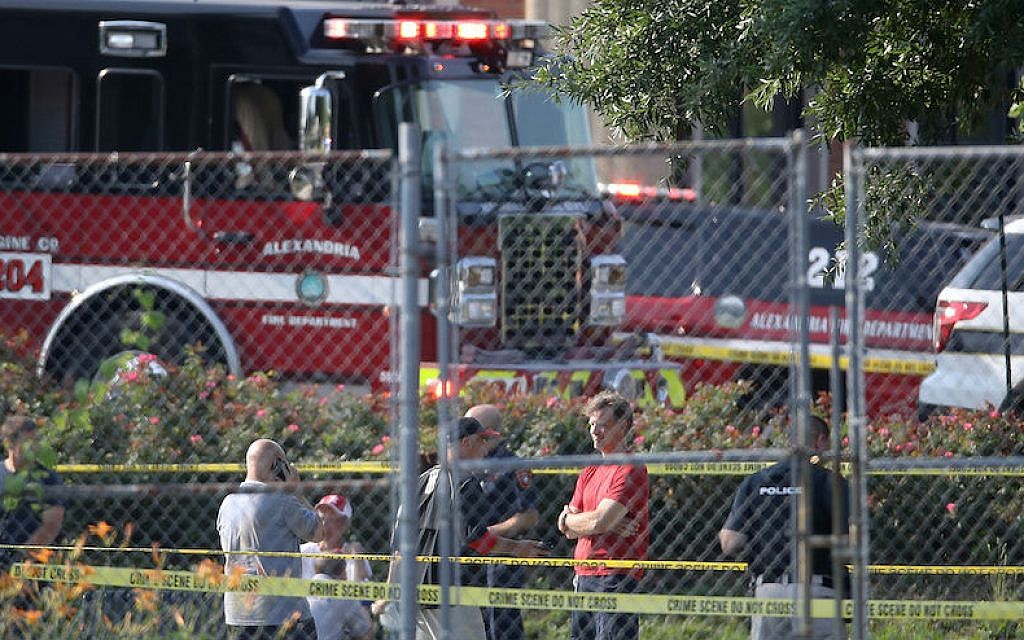 Investigators at Eugene Simpson Field in Alexandria, Va., the site where a gunman opened fire, June 14, 2017. (McNamee/Getty Images)