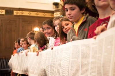 Students of the Joint Jewish Education Program — from Congregation Beth Shalom and Rodef Shalom Congregation — hold up an unrolled Torah scroll,Sunday, Oct. 7, in the main sanctuary of Rodef Shalom, to celebrate Simchat Torah, the holiday that marks the end of one Torah-reading cycle and the beginning of another. (Chronicle photo by Ohad Cadji)