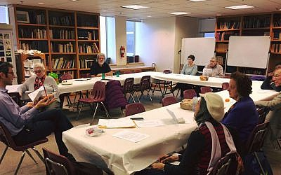Rabbi Seth Adelson and Lunch and Learn participants discuss compassion at a meeting earlier this year.	 (Photo courtesy of Congregation Beth Shalom)