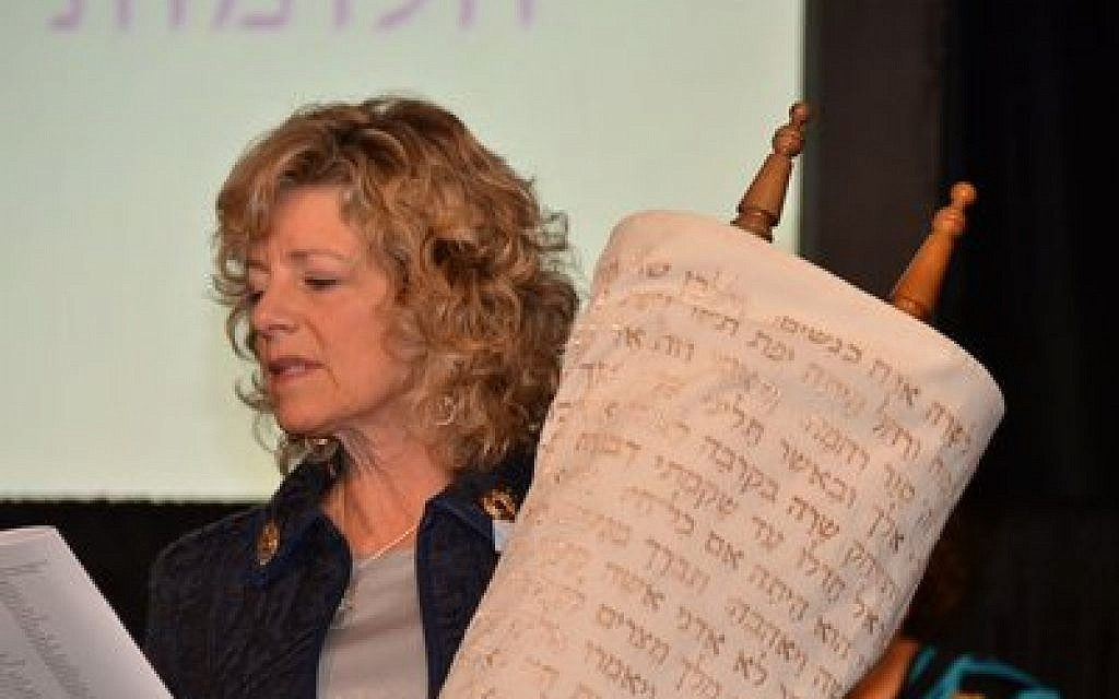Lynn Magid Lazar cradles the Torah of Women of Reform Judaism as she is installed for her second term as president of the affiliate of the Union for Reform Judaism.  Avigayil Halpern has wokred to include women's voices into her Torah study. (Photo courtesy of Dale Lazar)